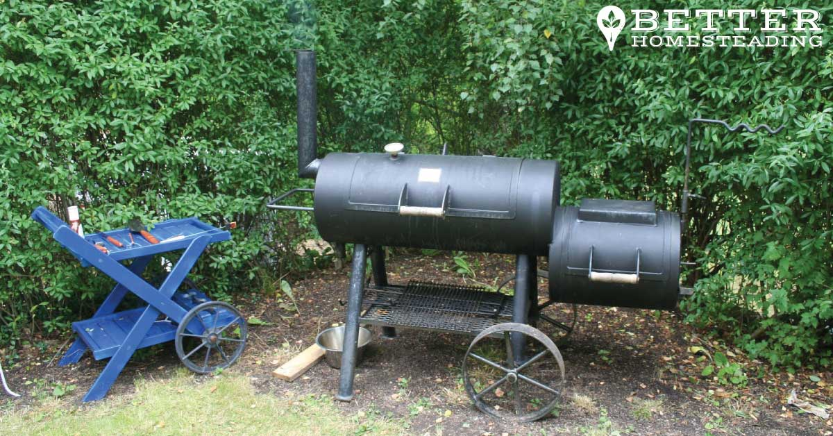Traditional offset barrel smoker in use