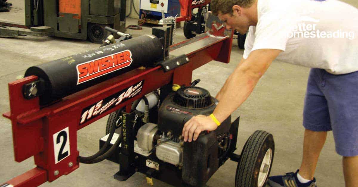 Man operating a gas log splitter