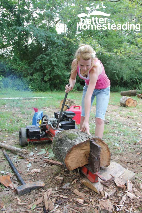 Woman splitting a log